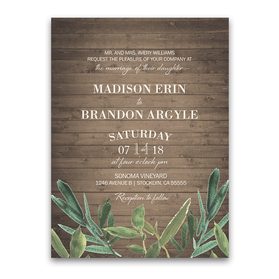 greenery wedding invitations on rustic barn wood